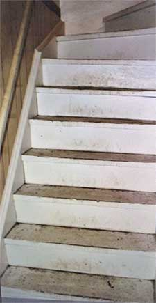 unpainted stairs before staging